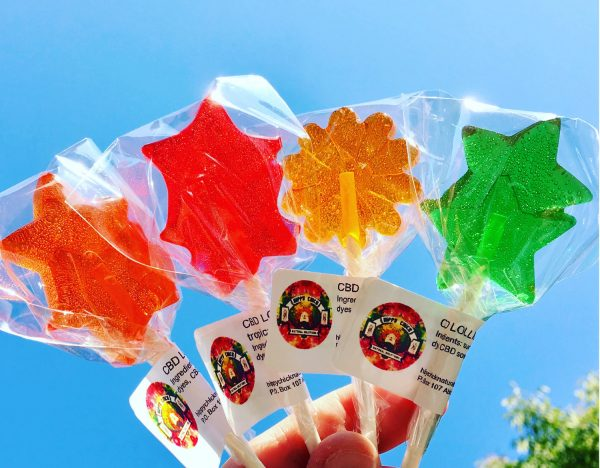 4 CBD Lollipops held up in the air